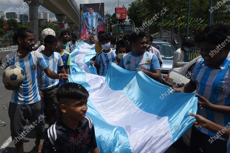 Stock Photo of Football fans with posters of Lionel Messi celebrate Argentina's victory in COPA America 2021, on July 11, 2021 in Kolkata, India.