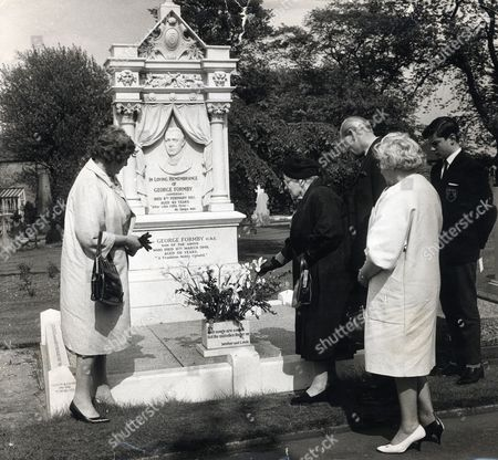 The Family Of Comedian George Formby Are Seen At His Grave To Celebrate The Anniversary Of His Birthday. George Died 6/3/1961 At The Age Of 56. Picture Shows Mrs Eliza Booth His Mother With The Flowers Mr Frank Booth His Brother Mrs Louise D Hale His Blonde Sister Mrs Joyce Edna Booth And Christopher Booth.