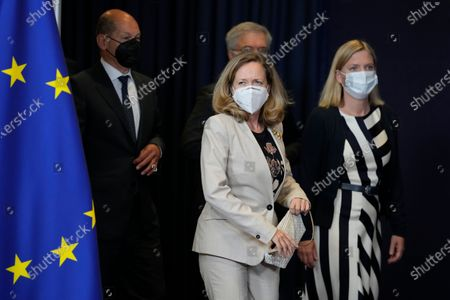 Spain's Minister for the Economy Nadia Calvino, center, and Sweden's Finance Minister Magdalena Andersson, right, arrive for a group photo of eurogroup finance ministers at the European Council building in Brussels on