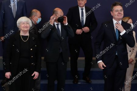 United States Secretary of the Treasury Janet Yellen (L), German Finance Minister and Vice Chancellor Olaf Scholz (C) and Eurogroup president Paschal Donohoe (R) during a family picture at the end of a meeting of Eurogroup Finance Ministers, at the European Council in Brussels, Belgium, 12 July 2021.