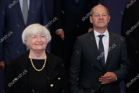 United States Secretary of the Treasury Janet Yellen (L) and German Finance Minister and Vice Chancellor Olaf Scholz (R) during a family picture at the end of a meeting of Eurogroup Finance Ministers, at the European Council in Brussels, Belgium, 12 July 2021.