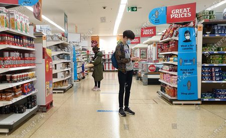 Editorial photo of Wearing face covering in shops may be scrapped from Freedon Day, London, UK - 12 Jul 2021