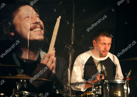Stock Image of Aled Richards plays with an image of Stuart Cable looking over him