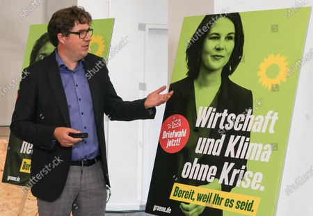Michael Kellner, party secretary of the German Greens Party (Die Gruenen) speaks next to a new Green party election poster showing Green party co-chairwoman and top candidate for the upcoming federal elections, Annalena Baerbock, during a press conference in Berlin, Germany, 12 July 2021. Michael Kellner presented the Green Party campaign for the 2021 German federal election.