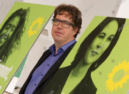 Michael Kellner, party secretary of the German Greens Party (Die Gruenen) poses next to new Green party election posters, after a Greens Party press conference in Berlin, Germany, 12 July 20121. Michael Kellner presented the Green Party campaign for the 2021 German federal election.