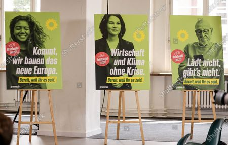 Green party campaign posters are seen  during a Greens Party press conference in Berlin, Germany, 12 July 2021. Michael Kellner presented the Green Party campaign for the 2021 German federal election.