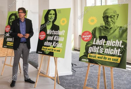 Michael Kellner, party secretary of the German Greens Party (Die Gruenen) poses next to new Green party election posters after a Greens Party press conference in Berlin, Germany, 12 July 2021. Michael Kellner presented the Green Party campaign for the 2021 German federal election.