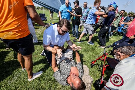 Irvine, CA, Sunday, July 11, 2021 - A brief scuffle breaks out involving a few opponents of Representative Katie Porter (D-CA45) as she conducts a town hall meeting with constituents at Mike Ward Community Park. (Robert Gauthier/Los Angeles Times)