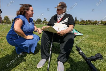 Irvine, CA, Sunday, July 11, 2021 - Representative Katie Porter (D-CA45) talks with David Calles, 77, of Santa Ana as she arrives for a town hall meeting at Mike Ward Community Park. Calles said he offered her suggestions on how to get reelected. (Robert Gauthier/Los Angeles Times)