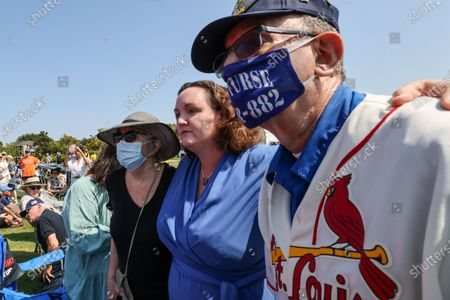 Irvine, CA, Sunday, July 11, 2021 - Representative Katie Porter (D-CA45) escorts two supporters from the scene of a scuffle during a town hall meeting with constituents at Mike Ward Community Park. (Robert Gauthier/Los Angeles Times)