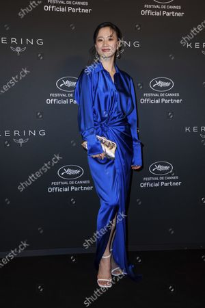 Meng Li poses for photographers upon arrival at the Kering Women In Motion Awards during the 74th international film festival, Cannes, southern France