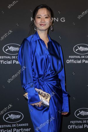 Stock Image of Meng Li poses for photographers upon arrival at the Kering Women In Motion Awards during the 74th international film festival, Cannes, southern France