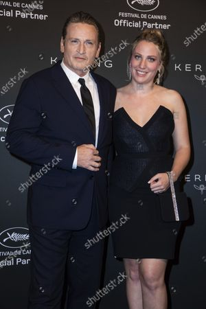 Benoit Magimel and Margot Pelletier pose for photographers upon arrival at the Kering Women In Motion Awards during the 74th international film festival, Cannes, southern France