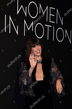 Lou Doillon poses for photographers upon arrival at the Kering Women In Motion Awards during the 74th international film festival, Cannes, southern France