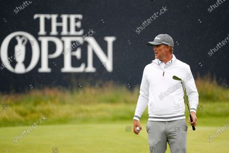 Stock Photo of Australia's Matt Jones looks around the 18th green during a practice round ahead of the start of the British Open Golf Championship at Royal St George's golf course Sandwich, England, . The Open begins Thursday July 15