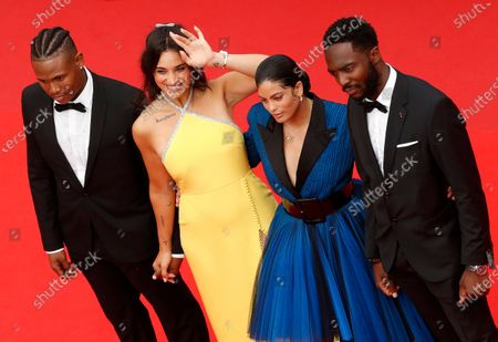 Stock Image of Aymerick Moucouveia, Camelia Jordana, Naomi Diaz and Yann Kidou arrive for the screening of 'The French Dispatch' during the 74th annual Cannes Film Festival, in Cannes, France, 12 July 2021. The movie is presented in the Official Competition of the festival which runs from 06 to 17 July.