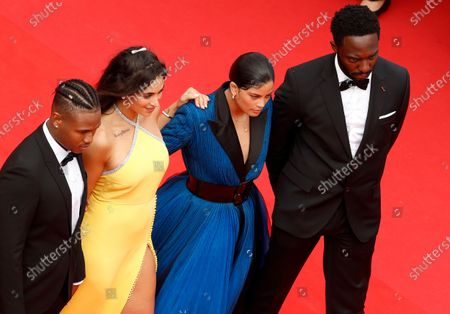 Aymerick Moucouveia, Camelia Jordana, Naomi Diaz and Yann Kidou arrive for the screening of 'The French Dispatch' during the 74th annual Cannes Film Festival, in Cannes, France, 12 July 2021. The movie is presented in the Official Competition of the festival which runs from 06 to 17 July.