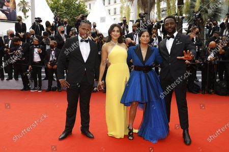 Stock Photo of Aymerick Moucouveia, Camelia Jordana, Naomi Diaz and Yann Kidou arrive for the screening of 'The French Dispatch' during the 74th annual Cannes Film Festival, in Cannes, France, 12 July 2021. The movie is presented in the Official Competition of the festival which runs from 06 to 17 July.