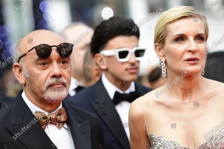 Christian Louboutin (L) and Melita Toscan du Plantier (R) arrive for the screening of 'The French Dispatch' during the 74th annual Cannes Film Festival, in Cannes, France, 12 July 2021. The movie is presented in the Official Competition of the festival which runs from 06 to 17 July.