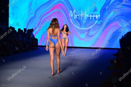 Stock Photo of A model walks the runway for during My Happy by Stef Roitman, Mery Racauchi and Mery Playa fashion show during Miami Swim Week FW21 at The PARAISO Tent