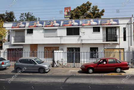 Stock Photo of Election posters hang outside a political campaign office during the Chilean election sporting the faces of current Sebastian Pinera and Marcela Sabat in Santiago, Chile, on March 12, 2010.