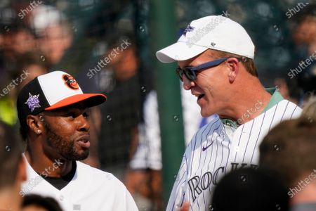 Former NFL quarterback Peyton Manning, right, speaks with American League's Cedric Mullins, of the Baltimore Orioles, during batting practice for the MLB All-Star baseball game, in Denver