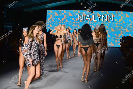 A model walks the runway for during Nia Lynn Collection by Nicole Williams English fashion show during Miami Swim Week FW21 at The PARAISO Tent