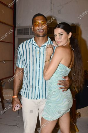 Stock Picture of Designer Nicole Williams English and husband NFL football player for the Tampa Bay Buccaneers Larry English backstage during Nia Lynn Collection by Nicole Williams English fashion show during Miami Swim Week FW21 at The PARAISO Tent