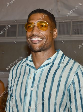 NFL football player for the Tampa Bay Buccaneers Larry English backstage during Nia Lynn Collection by Nicole Williams English fashion show during Miami Swim Week FW21 at The PARAISO Tent