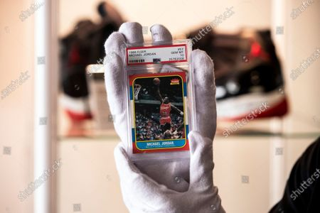 Stock Image of Michael Jordan 1986 fleer rookie card #57 is held by an employee during the preview of the auction 'Sports Legends' at Julien's auction in Beverly Hills, California, USA, 12 July 2021. The auction will take place on July 17 and 18, 2021.