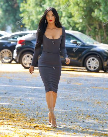 Megan Fox puts on an eye catching display as she made her way to Jimmy Kimmel Live on Monday afternoon. The actress wore a grey sleeved Alex Perry dress as she hopped into her car on the way to the taping. She wore a bold red lipstick and her long black hair down in a classy look.