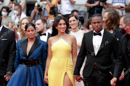 Camelia Jordana, Naomi Diaz, Aymerick Moucouveia and Yann Kidou are waiting for The French Dispatch Red Carpet during 74th Cannes International Film Festival, at the Palais des Festivals in Cannes, France, on July 12, 2021. 07/12/2021 - Cannes, France.