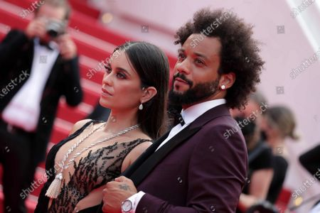 Marcelo Vieira and Clarisse Alves are waiting for The French Dispatch Red Carpet during 74th Cannes International Film Festival, at the Palais des Festivals in Cannes, France, on July 12, 2021. 07/12/2021 - Cannes, France.