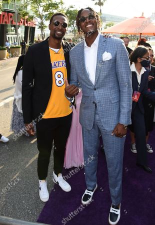 """Chris Bosh, left, and NBA basketball player Myles Turner, of the Indiana Pacers, arrive at the world premiere of """"Space Jam: A New Legacy"""", at Regal L.A. Live in Los Angeles"""
