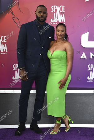 """Basketball player LeBron James, left, of the Los Angeles Lakers, and Savannah Brinson arrive at the world premiere of """"Space Jam: A New Legacy"""", at Regal L.A. Live in Los Angeles"""