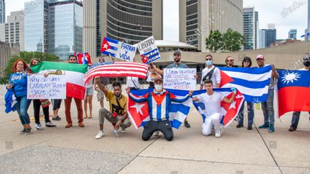 Members of the Cuban community in Toronto, Canada demonstrate in support of the protests for change in the Caribbean island. They are also demanding change in Cuba and the end of communism. The event takes place in Nathan Phillips Square.