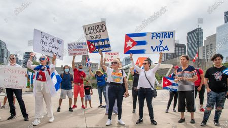 Stock Photo of Members of the Cuban community in Toronto, Canada demonstrate in support of the protests for change in the Caribbean island. They are also demanding change in Cuba and the end of communism. The event takes place in Nathan Phillips Square.