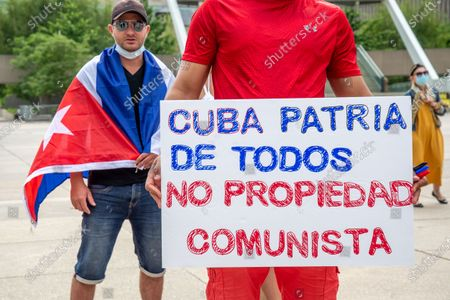 Stock Picture of Members of the Cuban community in Toronto, Canada demonstrate in support of the protests for change in the Caribbean island. They are also demanding change in Cuba and the end of communism. The event takes place in Nathan Phillips Square.