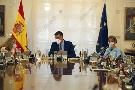 (L-R) Spanish first Deputy Prime Minister and Minister of Economy Nadia Calvino, Spanish Prime Minister Pedro Sanchez and second deputy Prime Minister and Labor Minister Yolanda Diaz attend the weekly Cabinet Meeting held at Moncloa Palace in Madrid, Spain, 13 July 2021. All new ministers are attending the weekly Cabinet Meeting for the first time after Sanchez carried out a remodeling of the Spanish cabinet.