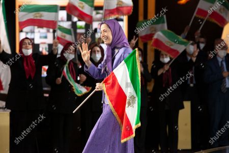 Stock Picture of Maryam Rajavi, Ashraf-3, Albania, 12/07/2021 - Maryam Rajavi, President-elect of National Council of Resistance of Iran (NCRI), waving the Iranian flag, on the third day of the Free Iran World Summit on July 11, 2021 in Ashraf 3 near Tirana., Albania. The third day of the Summit featured former prime ministers of Italy, Belgium, Sweden, Ireland, and Romania, AG Michael Mukasey, Amb. John Bolton, Mayor Rudy Giuliani, Senator Robert Torricelli, Directors Louis Freeh and James Woolsey and many others.