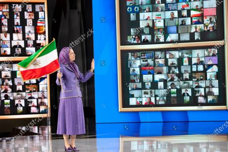 Maryam Rajavi, Ashraf-3, Albania, 12/07/2021 - Maryam Rajavi, President-elect of National Council of Resistance of Iran (NCRI), waving the Iranian flag, on the third day of the Free Iran World Summit on July 11, 2021 in Ashraf 3 near Tirana., Albania. The third day of the Summit featured former prime ministers of Italy, Belgium, Sweden, Ireland, and Romania, AG Michael Mukasey, Amb. John Bolton, Mayor Rudy Giuliani, Senator Robert Torricelli, Directors Louis Freeh and James Woolsey and many others.