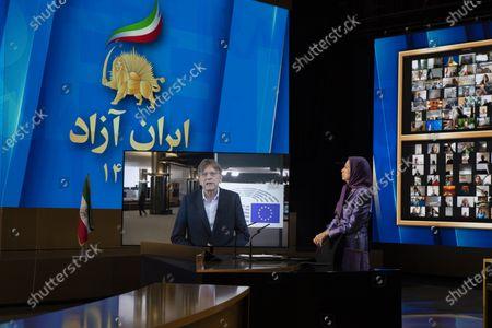 Maryam Rajavi, Ashraf-3, Albania, 12/07/2021 - Maryam Rajavi, President-elect of National Council of Resistance of Iran (NCRI), listening to Guy Verhofstadt, former Belgian Prime Minister, on the third day of the Free Iran World Summit  on July 12, 2021 in Ashraf 3, Albania.