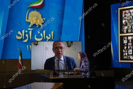 Maryam Rajavi, Ashraf-3, Albania, 12/07/2021 - Maryam Rajavi, President-elect of National Council of Resistance of Iran (NCRI), listening to Carlo Cottarelli, former Italian Prime Minister designate, on the third day of the Free Iran World Summit on July 12, 2021 in Ashraf 3, Albania.