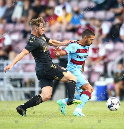 Manuel Lanzini of West Ham United  is fouled by Jack Sowerby of Northampton Town