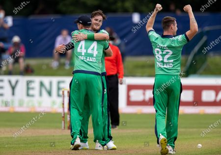 Ireland vs South Africa. Ireland's Mark Adair celebrates with Craig Young and Josh Little after taking the final South African wicket winning the game in the process