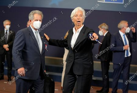 European Central Bank President Christine Lagarde, right, poses with Senior advisor to U.S. Treasury Secretary Janet Yellen, David Lipton, during a group photo of eurogroup finance ministers at the European Council building in Brussels on
