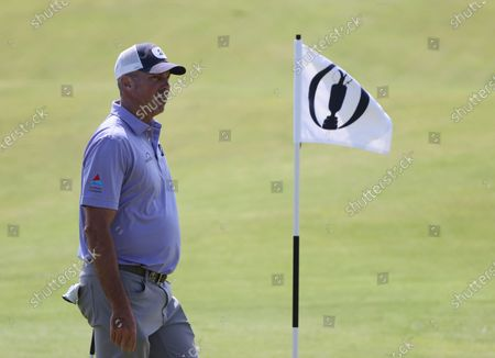 Stock Image of United States' Matt Kuchar walks on the 3rd green during a practice round for the British Open Golf Championship at Royal St George's golf course Sandwich, England, . The Open starts Thursday, July, 15