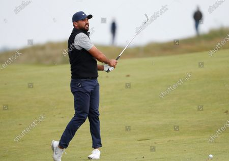 Australia's Jason Day watches his shot from the 3rd fairway during a practice round for the British Open Golf Championship at Royal St George's golf course Sandwich, England, . The Open starts Thursday, July, 15