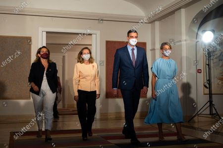 """Stock Photo of In this photo provided by the Spanish government, Spain's Prime Minister Pedro Sanchez, 3rd left walks with the 3rd Deputy Prime Minister and Minister for the Ecological Transition, Teresa Ribera, left, 1st Deputy Prime Minister and Economy Minister Nadia Calvino, 2nd left and 2nd deputy Prime Minister and Labour Minister Yolanda Diaz, right after a photocall with all the members of the Spanish government at the Moncloa Palace before a cabinet meeting in Madrid, Spain, . Sanchez has overhauled his Cabinet to form what he calls """"the government of the recovery"""" following the coronavirus pandemic"""