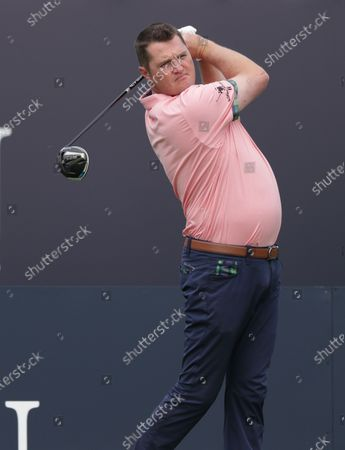 Jason Kokrak (USA) hits his tee shot on the 1st hole; The Royal St. George's Golf Club, Sandwich, Kent, England; The 149th Open Golf Championship, practice day.